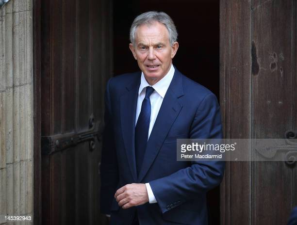 Former Prime Minister Tony Blair leaves The Royal Courts of Justice by a side door after giving evidence to The Leveson Inquiry on May 28 2012 in...
