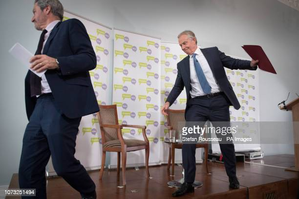 Former prime minister Tony Blair leaves the stage with host Gavin Esler after making a speech about Brexit in London today