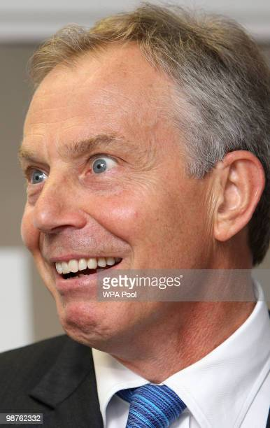 Former Prime Minister Tony Blair reacts during a visit to Alexandra Avenue Health and Social Care Centre in Harrow as he returned to the Labour...