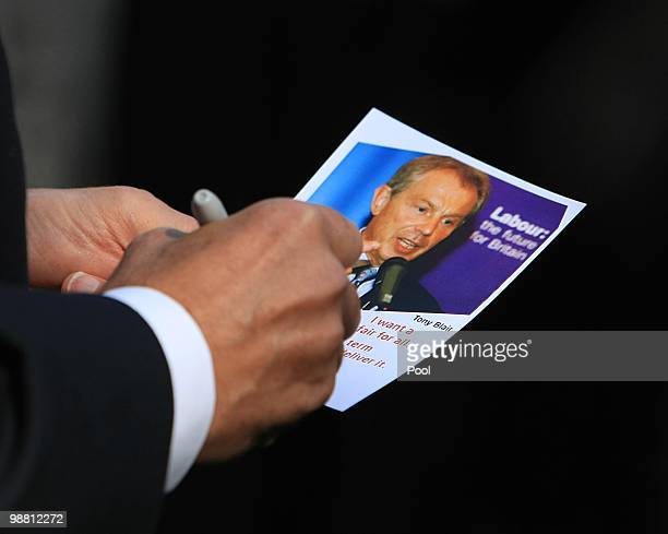 Former Prime Minister Tony Blair signs a campaign leaflet whilst out campaigning with former Home Secretary Jacqui Smith in her Redditch constituency...