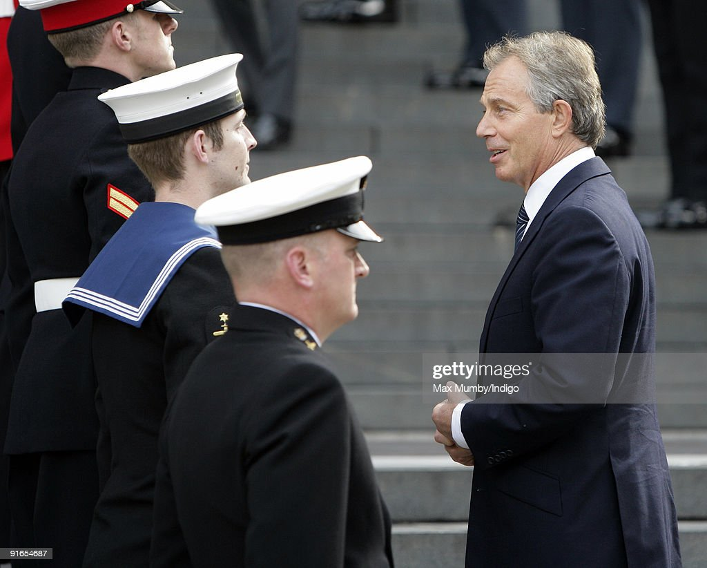 Former Prime Minister Tony Blair talks with military personnel as he attends a service of commemoration to mark the end of combat operations in Iraq at St Paul's Cathedral on October 9, 2009 in London, England.