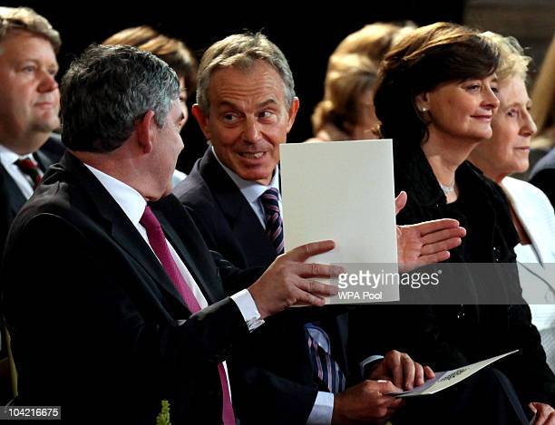 Former prime ministers Gordon Brown and Tony Blair chat as they wait for the arrival of Pope Benedict XVI at Westminster Hall on September 17, 2010...
