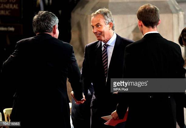 Former prime ministers Gordon Brown and Tony Blair greet each other as they wait for the arrival of Pope Benedict XVI at Westminster Hall on...