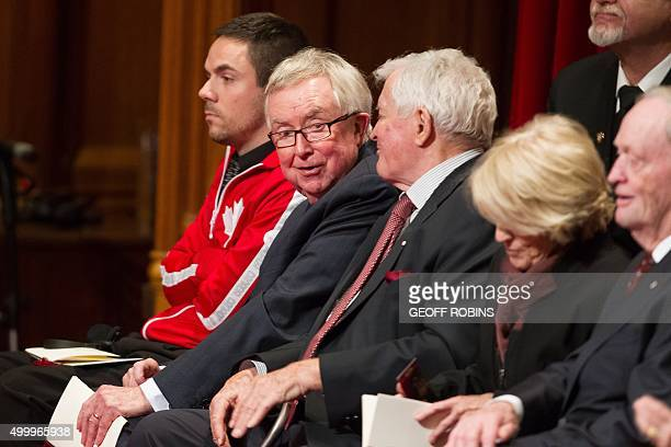Former Prime Ministers Joe Clark left and John Turner chat as the await the Speech from the Throne the start Canada's 42nd parliament in Ottawa...