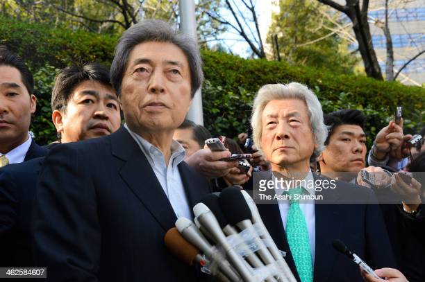 Former Prime Ministers Morihiro Hosokawa and Junichiro Koizumi answer questions from reporters after their meeting on January 14 2014 in Tokyo Japan...