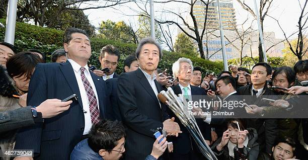 Former Prime Ministers Morihiro Hosokawa and Junichiro Koizumi answer questions from reporters after their meeting on January 14, 2014 in Tokyo,...