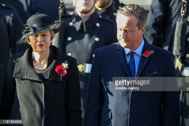 Former Prime Ministers Theresa May and David Cameron attend the Remembrance Sunday ceremony at the Cenotaph memorial in Whitehall central London...