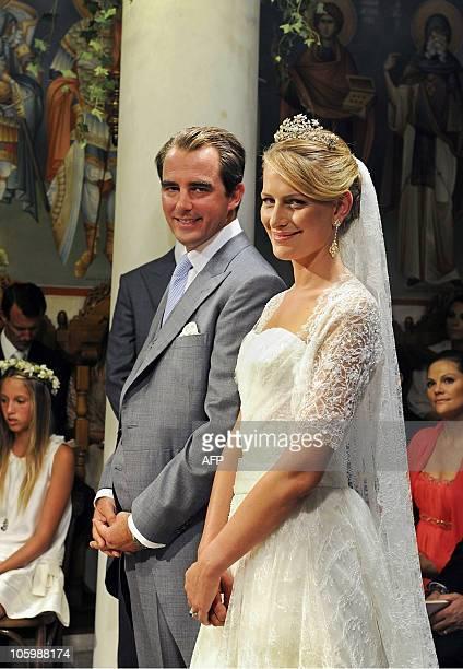 Former Prince Nicolas and Tatiana Blatnik pose during their wedding ceremony in Saint Nicolas orthodox church on the island of Spetses on August 25,...