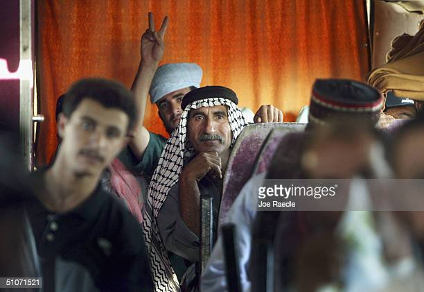 Former prisoners ride on a bus as they are release from Abu Ghraib prison on July 15 2004 west of Baghdad Iraq The US army released 65 prisoners that...