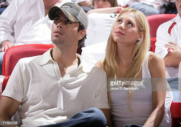 Former pro tennis player and model Anna Kournikova and musician Enrique Iglesias attend Game Three of the 2006 NBA Finals between the Miami Heat and...