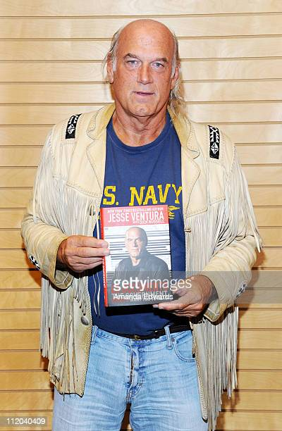 Former pro wrestler and former Minnnesota Governor Jesse Ventura poses before signing copies of his book 63 Documents The Government Doesn't Want You...