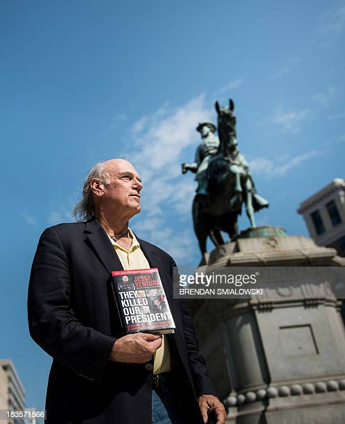 Former pro wrestler Jesse Ventura poses with a copy of his book They Killed Our President October 4 2013 in Washington DC Ventura who is considering...