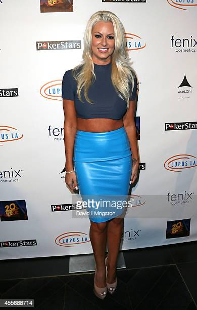 Former pro wrestler Maryse Ouellet attends the Stars Get Lucky For Lupus 6th Annual Poker Tournament at Avalon on September 18 2014 in Hollywood...