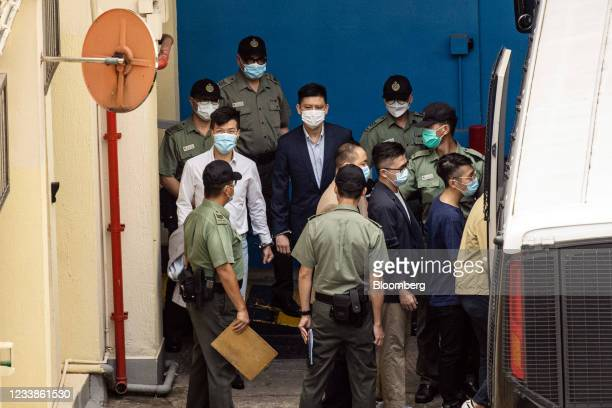 Former pro-democracy lawmakers Gary Fan Kwok-wai, top left, Jeremy Tam, top right, and walk towards a Correctional Services Department vehicle at the...