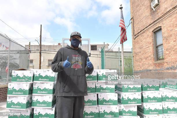 Former professional baseball player CC Sabathia distributes pantry boxes to Boys And Girls Club families at the Belmont Community Day Care Center on...