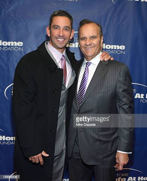 Former professional baseball player Jorge Posada and former professional baseball player/manager Joe Torre attend Joe Torre's Safe At Home...