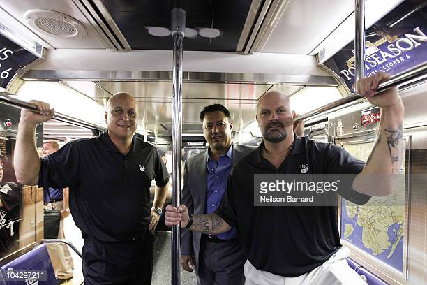 Former professional baseball players Cal Ripkin Jr., David Wells and Ron Darling attend the MLB on TBS 42nd Street Times Square shuttle unveiling at...
