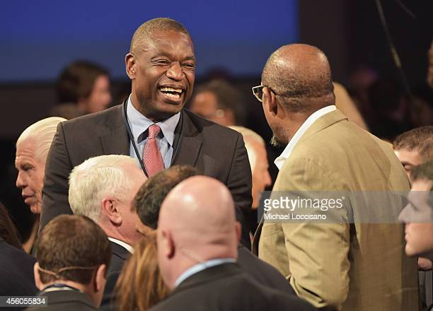 Former professional basketball player Dikembe Mutombo and Forest Whitaker attend the and Closing Plenary Session 'Aiming for the Moon and Beyond'...