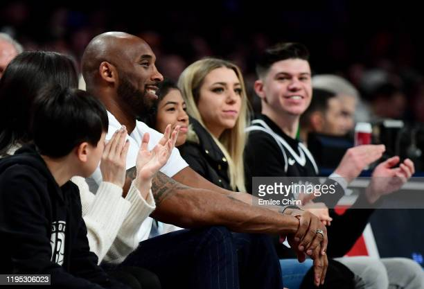 Former professional basketball player Kobe Bryant watches the Brooklyn Nets and Atlanta Hawks game during the first half at Barclays Center on...