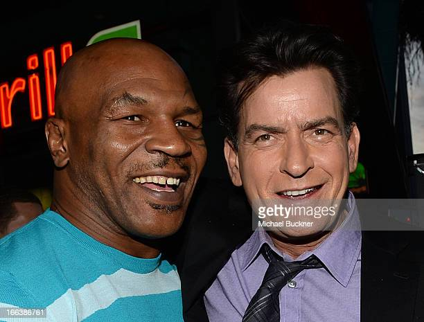 Former professional boxer Mike Tyson and actor Charlie Sheen arrive for the premiere of Dimension Films' Scary Movie 5 at ArcLight Cinemas Cinerama...