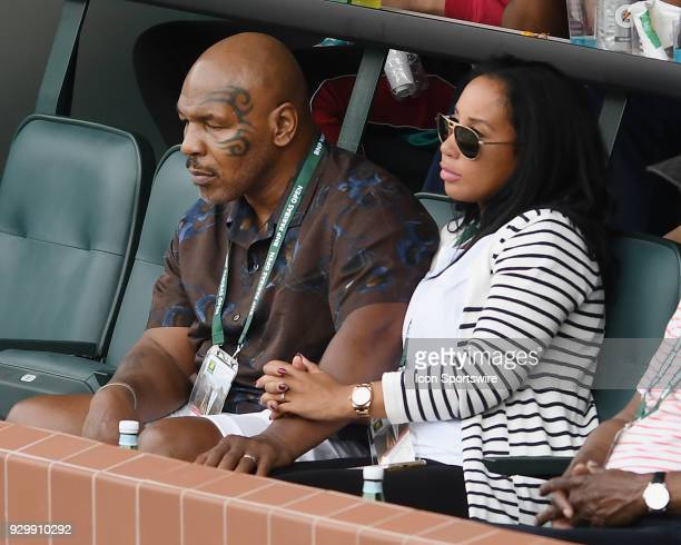 Former professional boxer Mike Tyson with his wife Lakiha Spicer in the stands on center court during the Simona Halep vs Kristyna Pliskova WTA...