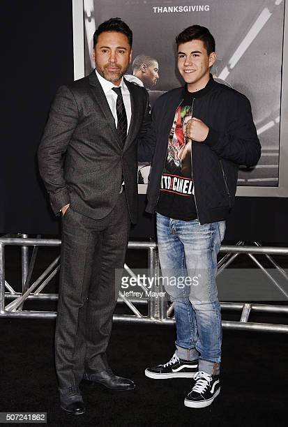 Former professional boxer Oscar De La Hoya and son Devon De La Hoya arrive at the premiere of Warner Bros Pictures' 'Creed' at Regency Village...