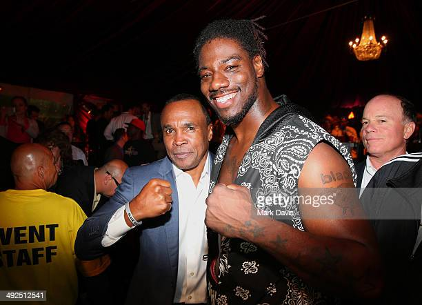 Former professional boxer Sugar Ray Leonard and boxer Charles Martin after Martin knocked out Rafael Pedro in a heavyweight bout during the B Riley...