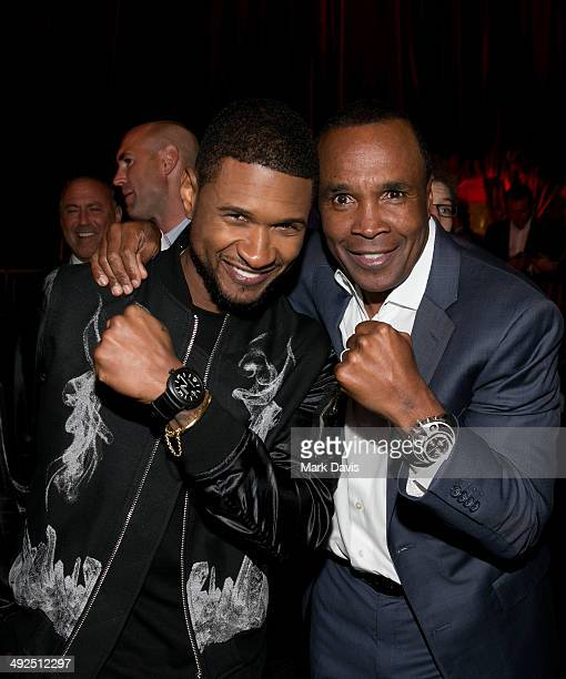 Former professional boxer Sugar Ray Leonard and recording artist Usher attend the B Riley Co and Sugar Ray Leonard Foundation's 5th Annual 'Big...