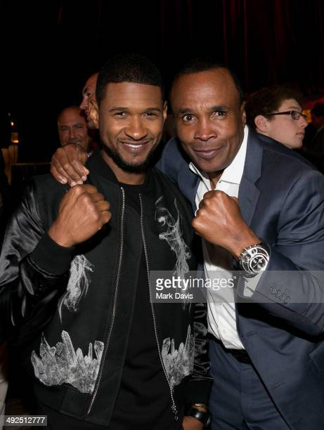 Former professional boxer Sugar Ray Leonard and recording artist Usher attend the B Riley Co and Sugar Ray Leonard Foundation's 5th Annual Big...