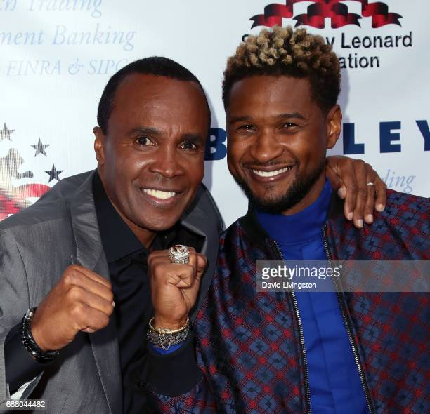 Former professional boxer Sugar Ray Leonard and singer Usher attend the 8th Annual 'Big Fighters Big Cause' Charity Boxing Night at the Loews Santa...
