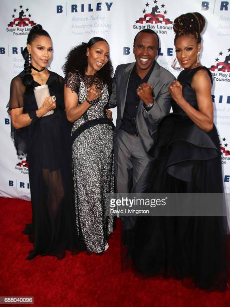 Former professional boxer Sugar Ray Leonard poses with singers Cindy HerronBraggs Terry Ellis and Rhona Bennett of 'En Vogue' at the 8th Annual Big...