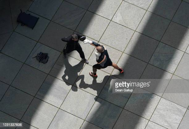 Former professional boxers Fabio Frittoli and Fabio Brusco spar on the banks of the Spree River in the government quarter during the coronavirus...