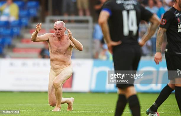Former professional football Lars Elstrup runs on to the pitch as a streaker during the Danish Alka Superliga match between Randers FC and Silkeborg...