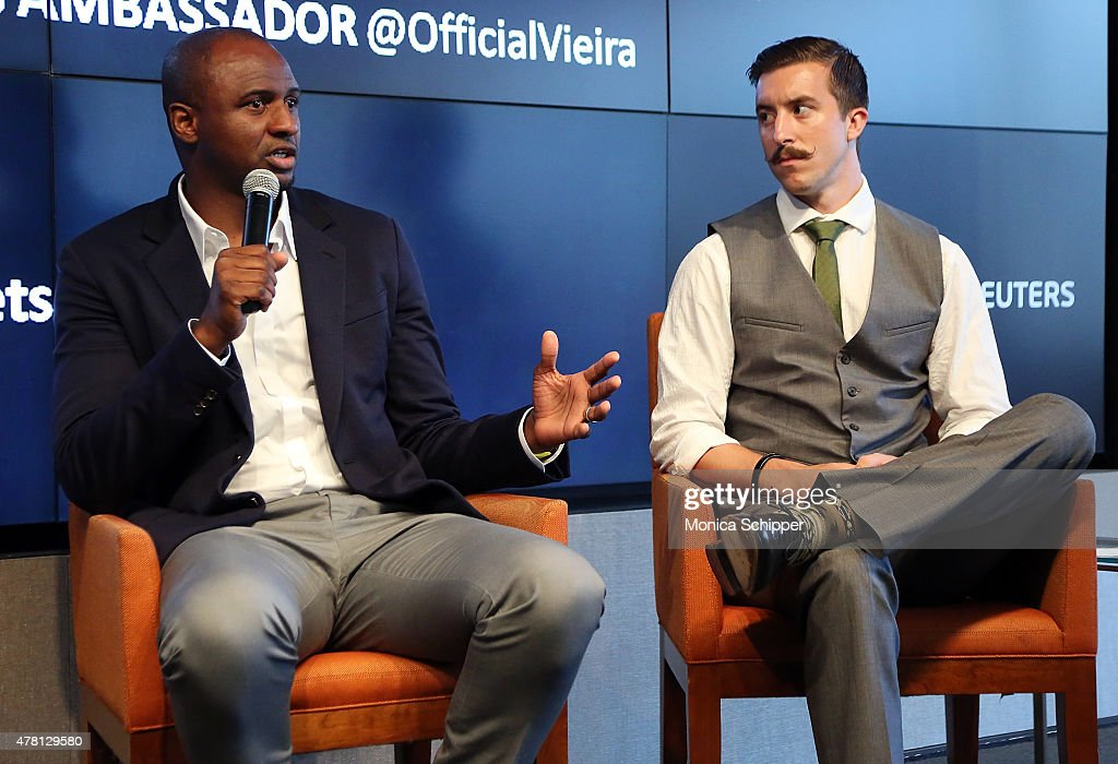 Former professional football player and Western Union Pass Ambassador Patrick Vieira (L) and professional football player with New York City FC, Jeb Brovsky, speak at the Beyond Soccer Series Powered By streetfootballworld at Thomson Reuters Building on June 22, 2015 in New York City.