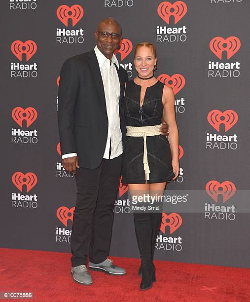 Former professional football player Eric Dickerson and Penny Sutton attend the 2016 iHeartRadio Music Festival at TMobile Arena on September 23 2016...