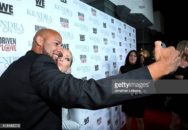 """Former professional football player Hank Baskett and TV personality Kendra Wilkinson attend WE tv's premiere of """"Kendra On Top"""" and """"Driven To Love""""..."""