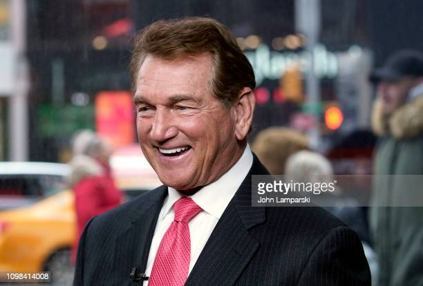 """Former professional football player Joe Theismann visits """"Extra"""" at the Levi's store in Times Square on January 23, 2019 in New York City."""