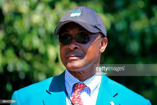 Former professional football player Lynn Swann looks on during the third round of the 2014 Masters Tournament at Augusta National Golf Club on April...