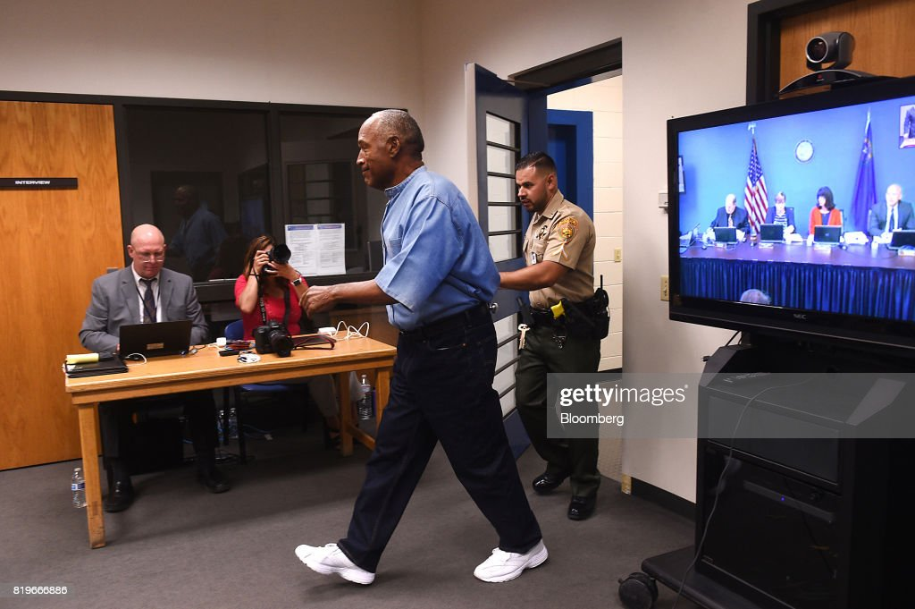 Former professional football player O.J. Simpson arrives for a parole hearing at Lovelock Correctional Center in Lovelock, Nevada, U.S. on Thursday, July 20, 2017. Simpson may learn, as early as Thursday afternoon, whether the Nevada Board of Parole Commissioners will decide to free him in the fall or whether he will continue to serve a nine-to-33-year sentence for 12 convictions, including kidnapping and armed robbery, stemming from a 2007 sting operation in which he tried to recover sports memorabilia from two collectors. Photographer: Jason Bean/Pool via Bloomberg