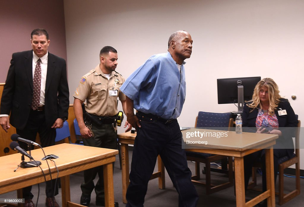 Former professional football player O.J. Simpson, center, exits after a parole hearing at Lovelock Correctional Center in Lovelock, Nevada, U.S., on Thursday, July 20, 2017. Simpson has been granted parole nine years into a 33-year sentence and could be released as soon as Oct. 1. Photographer: Jason Bean/Pool via Bloomberg