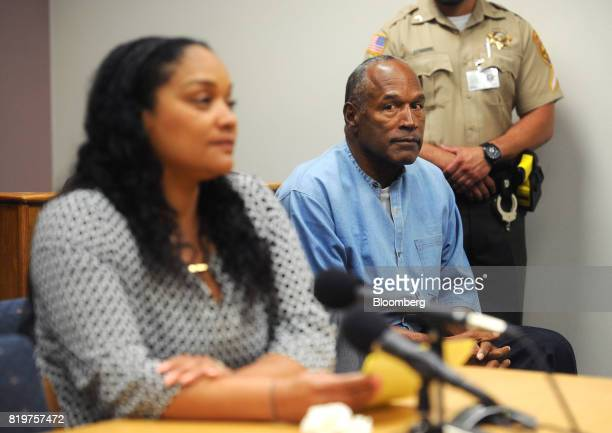 Former professional football player OJ Simpson center listens as his daughter Arnelle Simpson testifies during a parole hearing at Lovelock...
