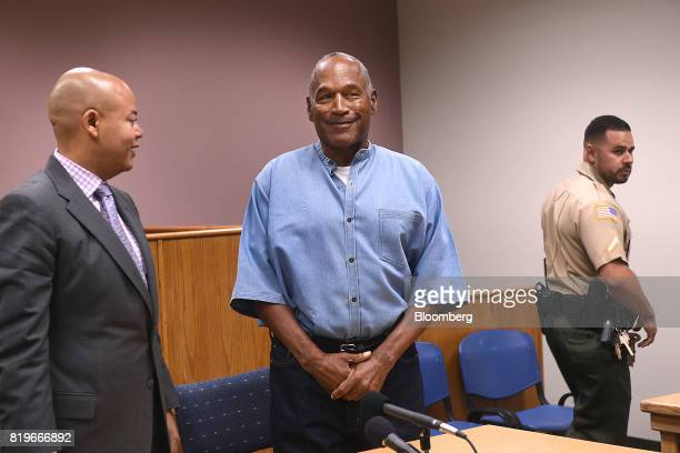 Former professional football player O.J. Simpson, center, stands during a parole hearing at Lovelock Correctional Center in Lovelock, Nevada, U.S.,...