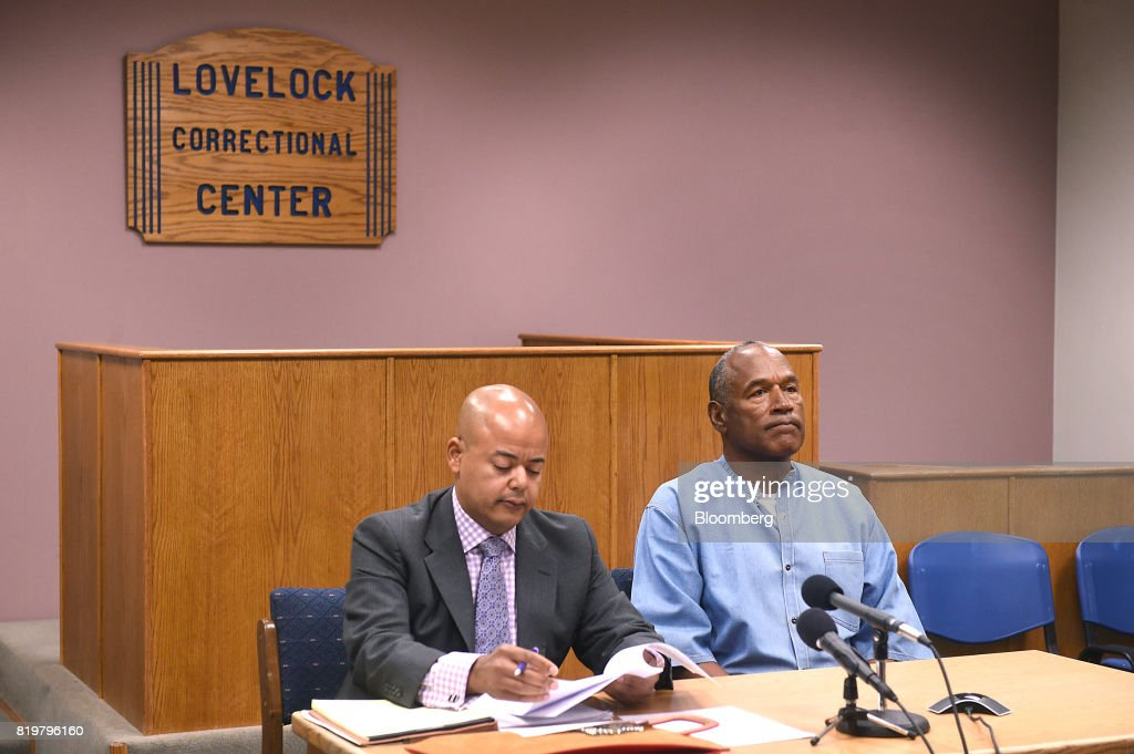 Former professional football player O.J. Simpson, right, listens during a parole hearing at Lovelock Correctional Center in Lovelock, Nevada, U.S., on Thursday, July 20, 2017. Simpson has been granted parole nine years into a 33-year sentence and could be released as soon as Oct. 1. Photographer: Jason Bean/Pool via Bloomberg