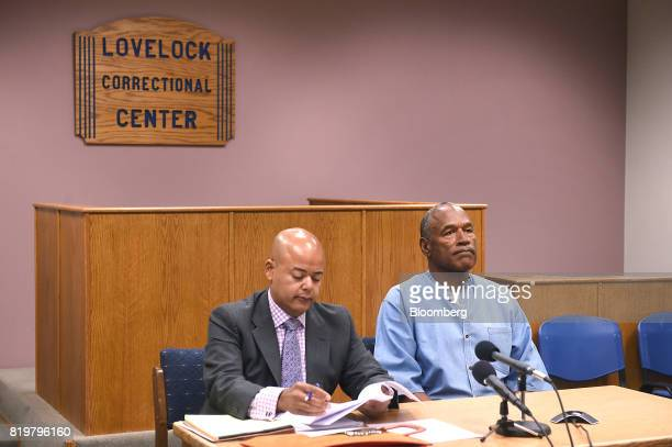 Former professional football player OJ Simpson right listens during a parole hearing at Lovelock Correctional Center in Lovelock Nevada US on...