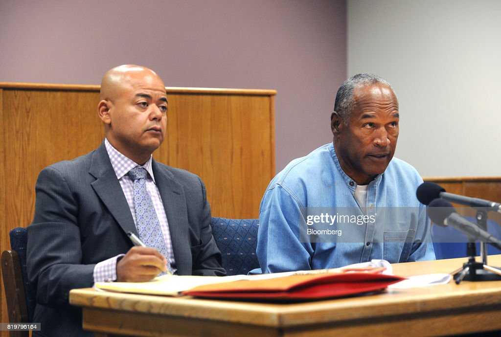 Former professional football player O.J. Simpson, right, speaks during a parole hearing at Lovelock Correctional Center in Lovelock, Nevada, U.S., on Thursday, July 20, 2017. Simpson has been granted parole nine years into a 33-year sentence and could be released as soon as Oct. 1. Photographer: Jason Bean/Pool via Bloomberg