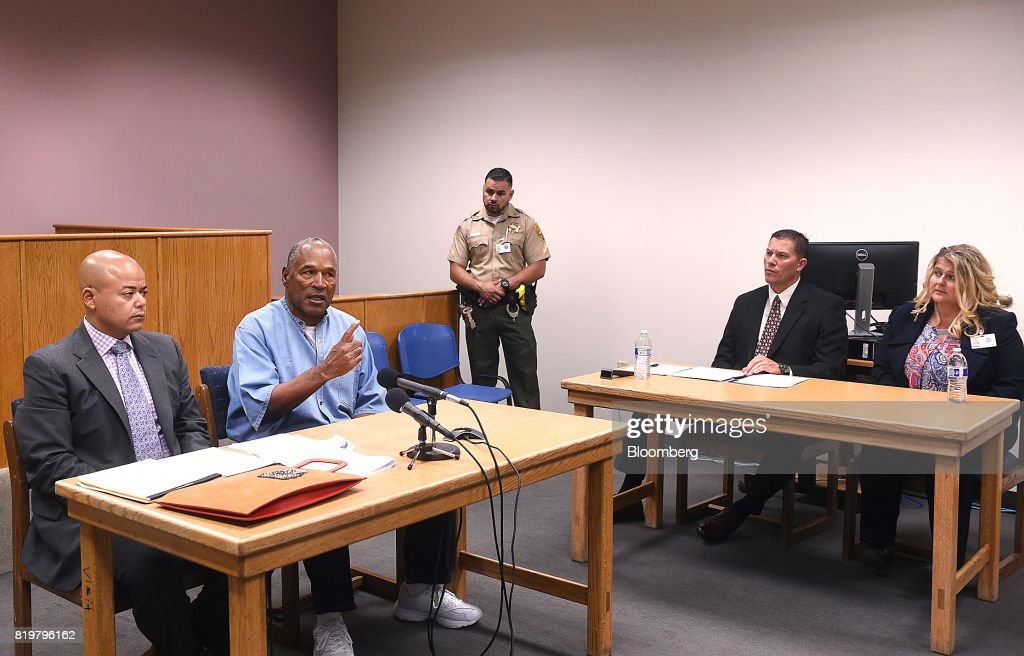 Former professional football player O.J. Simpson, second left, speaks during a parole hearing at Lovelock Correctional Center in Lovelock, Nevada, U.S., on Thursday, July 20, 2017. Simpson has been granted parole nine years into a 33-year sentence and could be released as soon as Oct. 1. Photographer: Jason Bean/Pool via Bloomberg