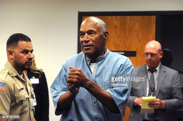 Former professional football player OJ Simpson speaks while leaving after a parole hearing at Lovelock Correctional Center in Lovelock Nevada US on...