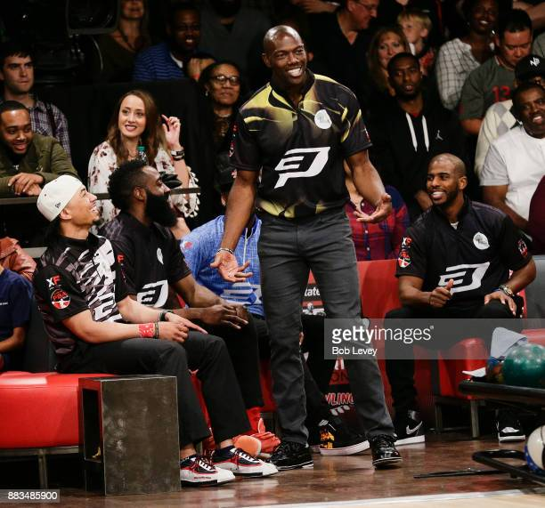 Former professional football player Terrell Owens along with Mookie Betts James Harden and Chris Paul from leftattends the State Farm Chris Paul PBA...