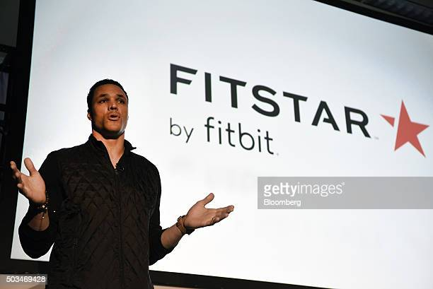 Former professional football player Tony Gonzalez speaks during a Fitbit Inc event at the 2016 Consumer Electronics Show in Las Vegas Nevada US on...
