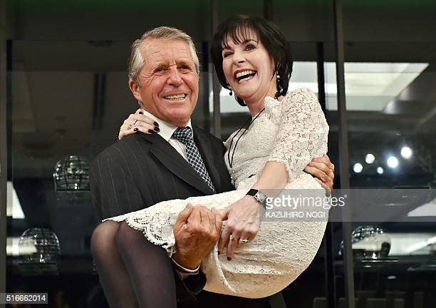 Former professional golfer Gary Player of South Africa holds Irish singersongwriter Enya during a photo session following a press conference in Tokyo...